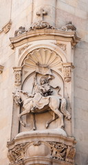 Ancient bas-relief on  wall of  Crusader in Barcelona