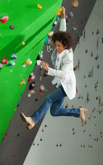 woman on artificial climbing wall