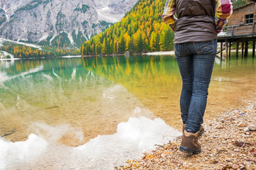 Closeup on woman walking on lake braies in south tyrol, italy