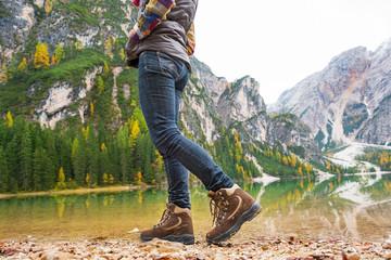 Closeup on woman walking on lake braies in south tyrol, italy