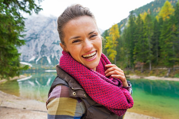 Portrait of happy woman on lake braies in south tyrol, italy