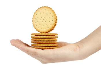 Stack of biscuits in woman hand isolated on white