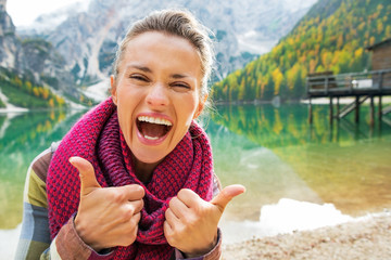 Portrait of happy young woman on lake braies in south tyrol