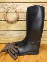 riding boots and gloves a stable