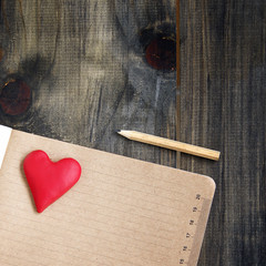 Heart lie on a notepad with Valentine's Day