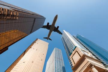 modern building underneath airplane