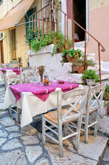 Traditional restaurant in a Corfu alley - Greece