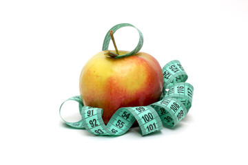 Measuring tape wrapped wave around an apple as a symbol of diet