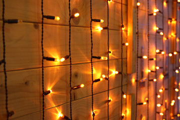 xmas lights on wood glowing background