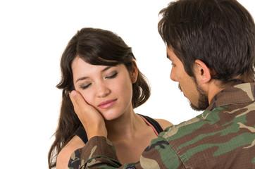 young hispanic military soldier saying goodbye to sad wife