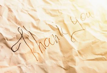 Black inscription on piece of paper
