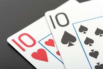 Two playing cards on grey