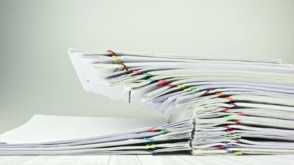 Overload of pile paperwork on table time lapse