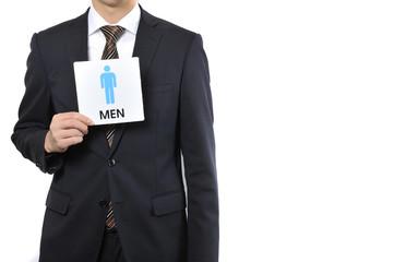 スーツの男性とトイレのマーク