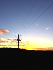 electricity pylon against the sunset in england