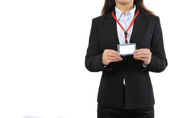 白背景とスーツの女性スタッフの上半身