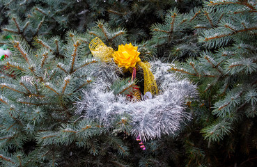 Garland on a snowy Christmas tree