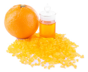 Orange essential oil with bath salt isolated on white