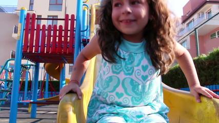 Young girl having fun on a slide
