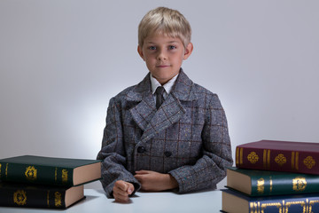 Serious boy among books