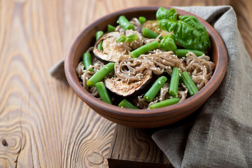 Buckwheat soba noodles with aubergine slices and beans