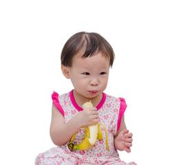Happy Asian girl eating banana. healthy food eating concept.