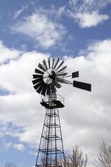 Windmill against blue cloudy sky