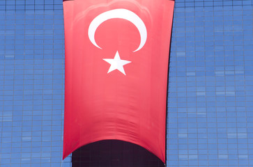 Huge Turkish flag hanging from a building