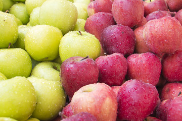 green and red wet apples