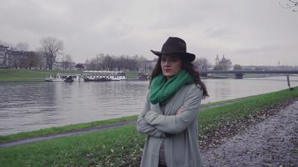 Pensive woman walking on boulevard, steadycam, slow motion shot