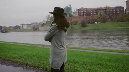 Sad woman walking on boulevard, steadycam shot, slow motion shot