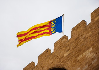 Flag of one of  regions of Spain - Valencia, on fortress wall