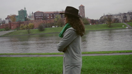 Sad woman walking on boulevard, steadycam, slow motion shot