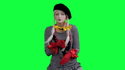 The mime sniffs and gives a flower
