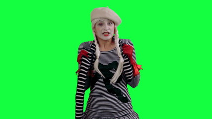 The mime feels cold and trying to keep warm