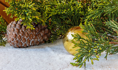 Christmas decorations, pine cones and Christmas tree branch in t