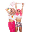Funny girl friends in pink wigs have fun with  unicorn