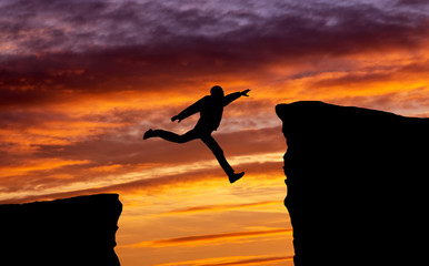 Man jumping across the gap