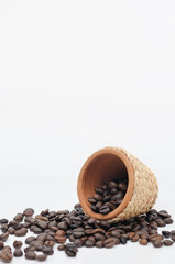 Mini clay pot with rattan rope and coffee seeds.