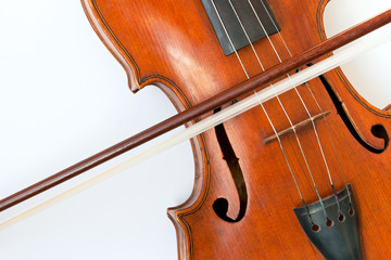Violin with a bow on a white background
