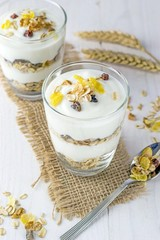 A healthy breakfast muesli and yoghurt mix layered in a glass