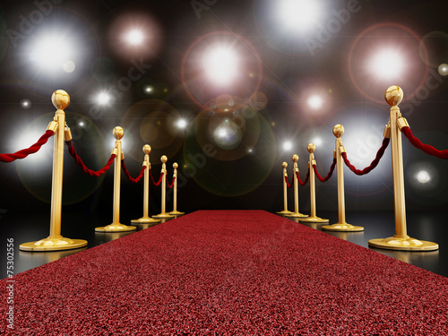 Red carpet at night with flashlights poster
