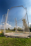 Arena for throwing hammer surrounded by safety net