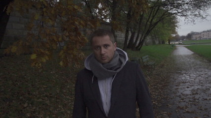 Pensive, man looking to the camera, steadycam shot, slow motion