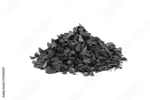 a handful of crushed charcoal on white background - 75304307