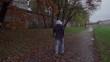 Man running on boulevard, steadycam shot, slow motion shot