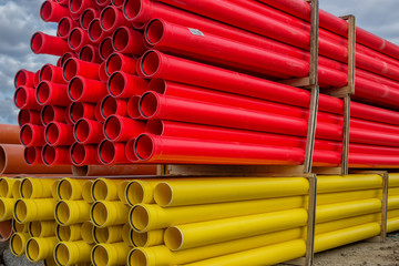 Stacks of various colored pvc water pipes
