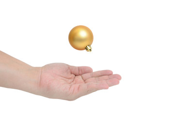 Man hand with floating gold ball.