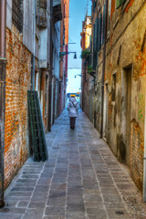 woman walking in an old backstreet