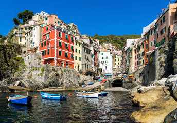 Riomaggiore village on cliff rocks and sea